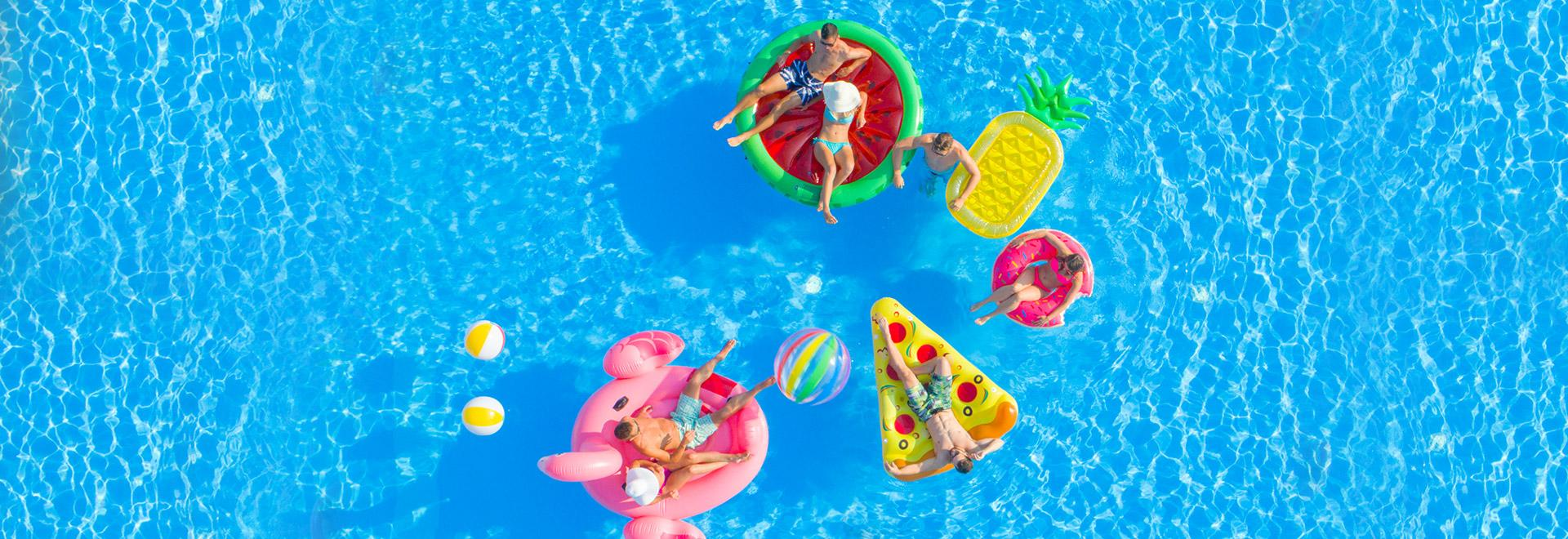 A group of friend enjoy floats in the pool