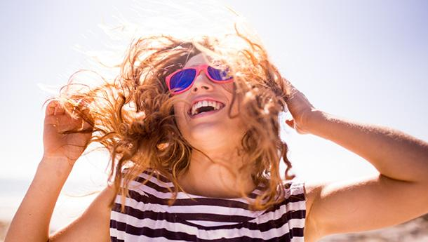 A girl laughs in the sunshine